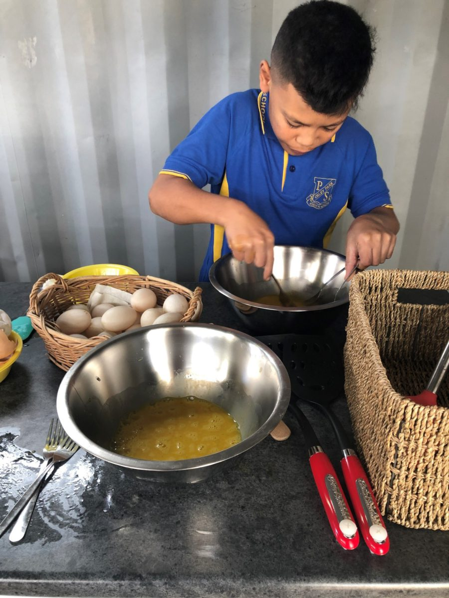 Student cooking FEAST recipe